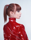 Studio portrait of youg beautiful woman in red PVC Stock Photos