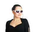 Studio portrait of young beautiful woman wearing white sunglasses Stock Photography