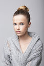 Studio portrait of young female in gray woolen cardigan Stock Photos