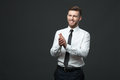 Studio portrait of young happy handsome businessman claping hand Royalty Free Stock Photo