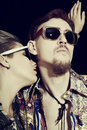 Studio portrait of young men and women wearing a stylish sunglasses Royalty Free Stock Photo