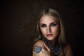 Studio shoot of  blonde woman with jewelry. Fashion portrait. Royalty Free Stock Photo