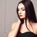 Studio shoot of woman with creative make up young attractive bright sexy girl thoughtfull brunette Stock Images