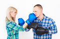 Studio shot of a beautiful funny couple expressive fighting.