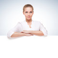 Studio shot of beautiful young smiling woman over blue gradient white background Royalty Free Stock Photo