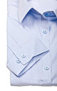 Studio Shot of blue men`s shirts on a white background. Royalty Free Stock Photo