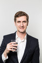 Studio shot of businessman with a glas of sparkling water Royalty Free Stock Photo