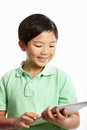 Studio Shot Of Chinese Boy With Digital Tablet Royalty Free Stock Images