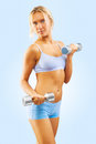 Studio shot a fitness girl with dumbbells Royalty Free Stock Images