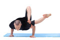 Studio shot of flexible man posing in asana middle aged Stock Photography