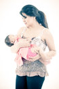 Studio shot of loving mother holding baby this image has attached release Royalty Free Stock Photo