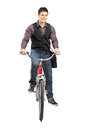 A studio shot of a man riding a bike Royalty Free Stock Photography