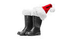 Studio shot of a pair of santa boots and santa hat Stock Photos