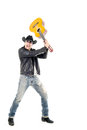 Studio shot pictures on isolated background of a rocker man breaking a guitar Royalty Free Stock Photography