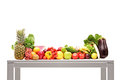 A studio shot of pile of fruits on a table Royalty Free Stock Images