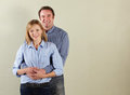Studio Shot Of Relaxed Middle Aged Couple Royalty Free Stock Photos