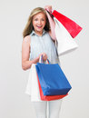 Studio shot of teenage girl with shopping bags smiling to camera Stock Images