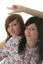Studio shot of two trendy teen girls Stock Image