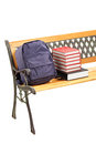 Studio shot of a wooden bench with books and school bag on it isolated white background Stock Photo