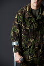 Studio Shot Of Wounded Soldier Using Crutch Royalty Free Stock Photo