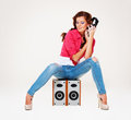 Studio shot of young woman listening the music Royalty Free Stock Photo