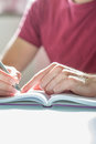 Studious man writing on his notebook on the table close up hand of a with fountain pen top of Stock Photo
