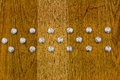 Studs on wood Royalty Free Stock Photo