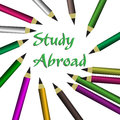 Study abroad abstract colorful background with colored pencils and the text written with green letters in the middle of the image Royalty Free Stock Photos