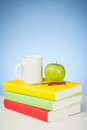 Study books and a snack on white desktop Stock Image