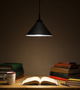 Study books on wooden table under lamp light Royalty Free Stock Images