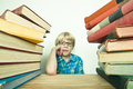 Study child thinking about his pile of homework Royalty Free Stock Photography