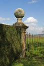 Study of a country house stone gate and post cotswols style close up garden with topiary in the cotswolds Royalty Free Stock Photo