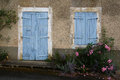 A study of an old blue wooden door and shuttered window Royalty Free Stock Photo