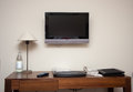 Study room with writing desk keyboard phone lamp and lcd tv set Royalty Free Stock Photo