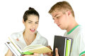 Study time a couple of teens discussing lessons Stock Image