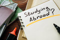 Studying abroad concept notepad on the table Royalty Free Stock Image