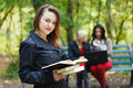 Studying for exams beautiful student girls in the university campus Stock Photography