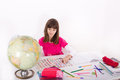 Studying geography schoolgirl by looking at earth globe and flags Royalty Free Stock Photos
