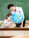 Studying geography with terrestrial globe Royalty Free Stock Photography