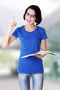 Studying happy young woman reading her notebook Stock Photography