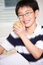 Studying kid eating apple Royalty Free Stock Photography
