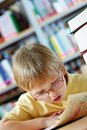 Studying map portrait of clever boy looking at in library Royalty Free Stock Image