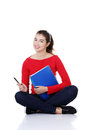 Studying thoughtful young woman reading notebook. Royalty Free Stock Photo