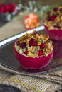 Stuffed baked red apples with granola, cranberries and marzipan Royalty Free Stock Photo
