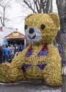 Stuffed bear in the park at Carnaval. People shoot at a dash Royalty Free Stock Photo