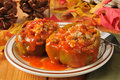 Stuffed bell peppers green with sausage rice and tomato sauce Royalty Free Stock Photo