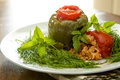 Stuffed bellpepper and tomatoes dolmas seasoned riice domatoes served with greens Royalty Free Stock Image