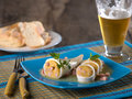Stuffed Calamari squid on blue plate Royalty Free Stock Photo