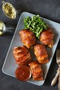 Stuffed chicken breasts rolled in bacon Royalty Free Stock Photo