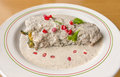 Stuffed chile en nogada mexican food very popular dish known as which is with ground beef and topped with a walnut based cream Royalty Free Stock Image